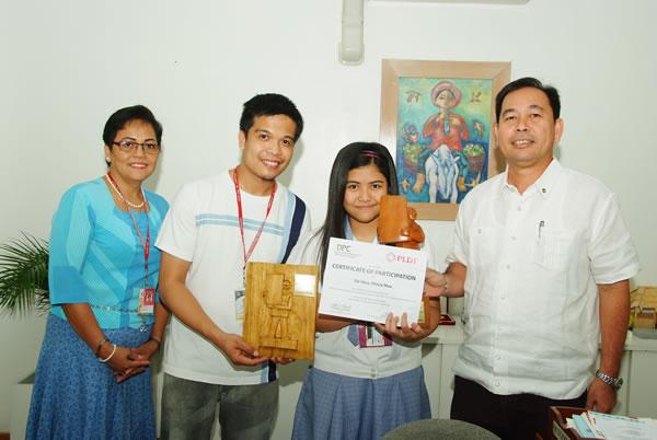 Shiela Mae De Vera with Principal Santos, Class Adviser Policarpio & Chancellor Battad
